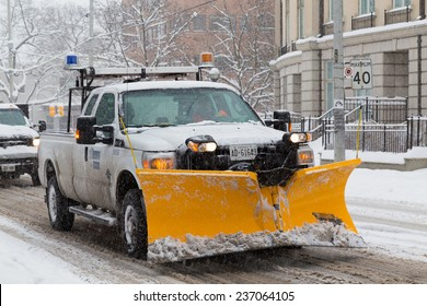 TORONTO, CANADA - 11TH DECEMBER 2014: Truck with a snowplow fitted on a street in Toronto
