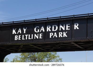 TORONTO, CANADA - 14TH MAY 2015: The words 'Kay Gardner Beltline Park' on a bridge over Yonge Street in Toronto