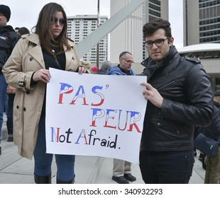 TORONTO, CANADA - 14th November  Saturday 2015: Hundreds of people paid tribute to victims of deadly attacks in Paris during a vigil at Nathan Phillips square in Toronto,Canada on November 14, 2015