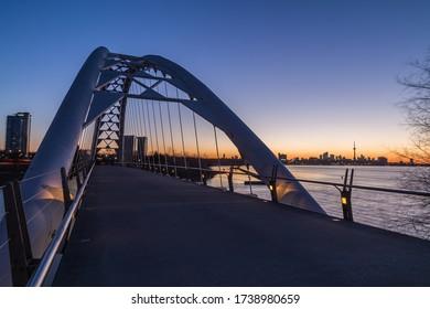 TORONTO, CANADA - 15TH APRIL 2015: Humber Bridge and part of the Toronto skyline at sunrise.