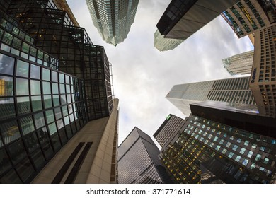 TORONTO CANADA 16-10-2015:Office buildings stretch up to the blue sky in the financial district in downtown. Toronto has prominent buildings in a variety of styles by many famous architects.