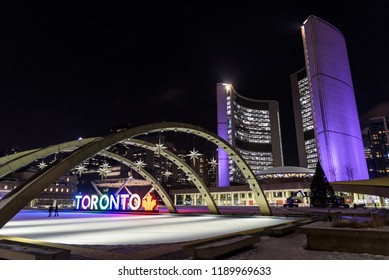 Toronto, Canada - 18 January, 2018: Night view of the Toronto City Hall at night with people who skate on the ice.