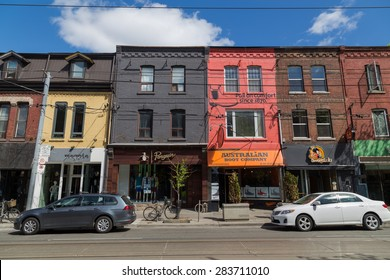 TORONTO, CANADA - 19TH MAY 2015: A view along Queen Street in Toronto showing businesses and buildings.