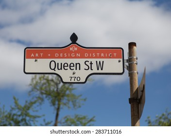 TORONTO, CANADA - 19TH MAY 2015: A sign for Queen Street West in the Art and Design District of Toronto