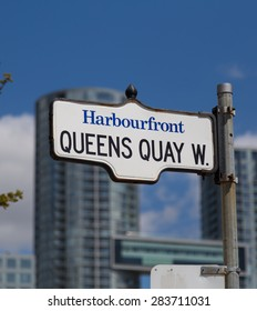 TORONTO, CANADA - 19TH MAY 2015: A sign for Queens Quay West in Toronto in the Harbourfront District