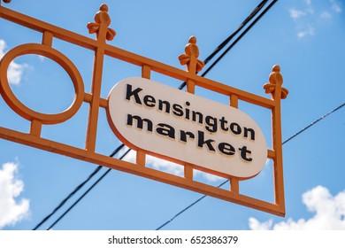 Toronto, Canada - 2 July 2016: Kensington Market street sign over blue sky - Kensington Market is a famous multicultural neighbourhood in Downtown Toronto, Ontario, Canada.