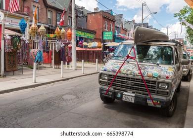 Toronto, Canada - 2 July 2016: Colorful truck on Kensington Avenue in the Kensington market District in Toronto, Canada.