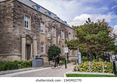 Toronto, Canada - 20 10 2018: A cyclist in front of the Canadiana Gallery building wich is a home for the Centre for Criminology & Sociolegal Studies of the University of Toronto.