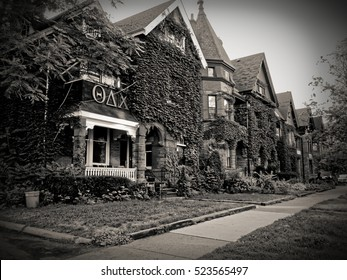 TORONTO, CANADA - 2011/08/10: View on old houses of Madison ave with THETA DELTA CHI Fraternity at University of Toronto home in front. ??? founded in 1847 is the eleventh oldest college fraternity.