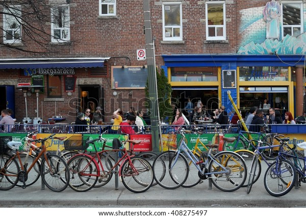 TORONTO, CANADA - 2016:  A curbside outdoor restaurant/bar in an area populated by students, as seen in Toronto circa 2016.