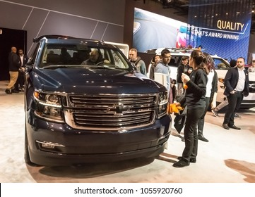 Toronto, Canada - 2018-02-19 : Visitors of 2018 Canadian International AutoShow beside the new 2018 Chevrolet Suburban SUV on the Chevrolet division of General Motors Corporation exposition