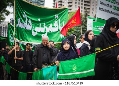 Toronto, Canada -20th Sep 2018: Muslim people participating the Ashura Day Procession, organized by the Shia Community to commemorate the martyrdom of Imam Husayn.