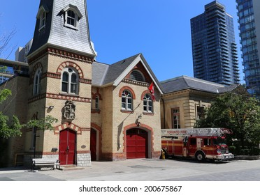 TORONTO, CANADA - 22 JUNE 2014: The outside of a Firestation in Toronto during the day with a Fire Truck parked outside