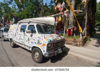 Toronto, Canada - 24 June 2017: Truck covered with stickers on Kensington Avenue in the Kensington Market District.