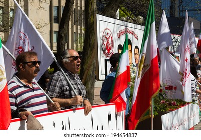 TORONTO, CANADA - 24TH MAY 2014: People at a demonstration in Toronto, protesting for the release of 7 hostages from camp Ashraf's in Iraq
