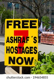 TORONTO, CANADA - 24TH MAY 2014: A sign at a demonstration in Toronto, protesting for the release of 7 hostages from camp Ashraf's in Iraq