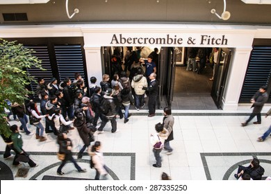 Toronto, Canada - 26 December, 2007 - people wait in line to enter an Abercrombie & Fitch's store.