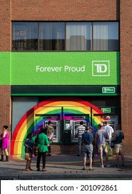 TORONTO, CANADA - 26 JUNE 2014: Rainbow decoration around the ATM's for a TD Bank branch in celebration of the World Pride Festival