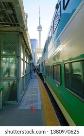 TORONTO, CANADA -26 MAR 2019- View of green and white GO transit commuter trains at the Union Station in downtown Toronto, Ontario, Canada.