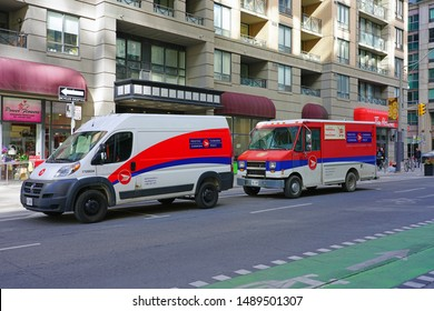 TORONTO, CANADA -26 MAR 2019- View of a Canadian postal van from Postes Canada Post on the street in Toronto, Ontario.