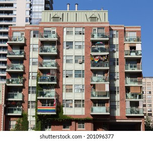 TORONTO, CANADA - 26TH JUNE 2014: Condos down Church Street in Toronto, showing flags in support of World Pride