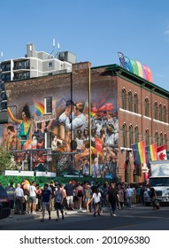 TORONTO, CANADA - 26TH JUNE 2014: Large amounts of people queuing to get in to an event down Church for World Pride