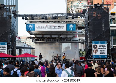 TORONTO, CANADA - 26TH JUNE 2014: A far view of a band playing on a stage in Yonge Dundas Square for Aboriginal History Month