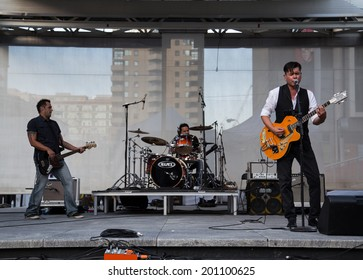 TORONTO, CANADA - 26TH JUNE 2014: Derek Miller performing on stage at Yonge Dundas Square for the Aboriginal History Month event