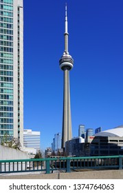 TORONTO, CANADA -27 MAR 2019- Day view of the landmark CN Tower, a communications and observation tower located in downtown Toronto, Ontario, Canada.