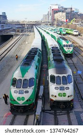 TORONTO, CANADA -27 MAR 2019- View of green and white GO transit commuter trains at the Union Station in downtown Toronto, Ontario, Canada.