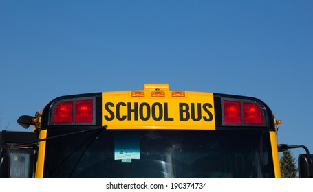 TORONTO, CANADA - 27TH APRIL 2014: Closeup to the School Bus words on a Yellow School bus in Toronto