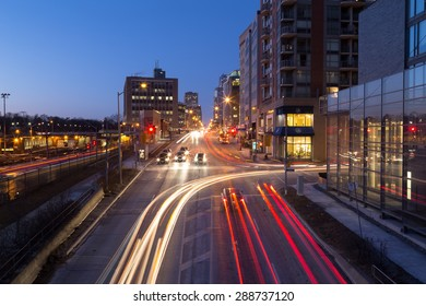 TORONTO, CANADA - 27TH JANUARY 2015: A view up Yonge Street towards Davisville showing the blur of traffic on the road and buildings