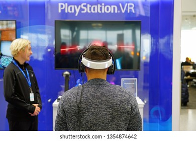 TORONTO, CANADA -29 MAR 2019- View of people playing the new Sony Playstation VR PS4 game box at the Toronto Pearson International Airport (YYZ).