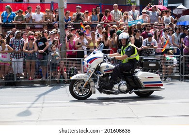 TORONTO, CANADA - 29TH JUNE 2014: Police Security on a Motorbike for the World Pride Parade in Toronto