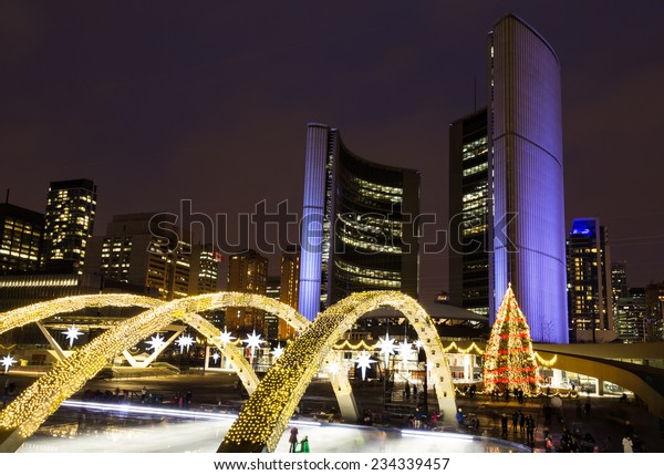TORONTO, CANADA - 30TH NOVEMBER 2014: Toronto City Hall at night at Christmas, showing lights around the front of the building and the Christmas tree.