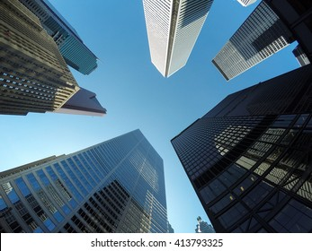 TORONTO, CANADA - 4TH JUNE 2015: A low angle view of buildings in downtown Toronto during the day.
