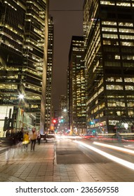 TORONTO, CANADA - 9TH DECEMBER 2014: King Street in Toronto at night showing the blur of traffic and people