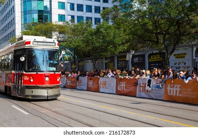 TORONTO, CANADA - 9TH SEPTEMBER 2014: Spectators on on the street for the Tiff festival in Toronto