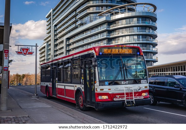 TORONTO, CANADA - APRIL 01, 2020: Toronto Transit Commission bus with a sign asking to board the rear door only due to the COVID 19 pandemic