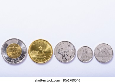 Toronto, Canada - April 1, 2018: Various types of Canadian circulation coins lay out against a white background to help identify coins