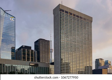 TORONTO, CANADA - APRIL 10, 2018: The CN Tower top behind the Sheraton Centre Hotel and other skyscrapers  buildings in Downtown Toronto