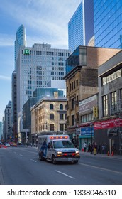 TORONTO, CANADA - APRIL 17, 2018:  Toronto Paramedic Services ambulance car in motion with sirens on at Yonge Street in Downtown Toronto