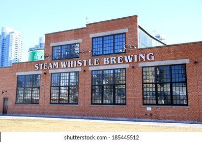 TORONTO, CANADA - APRIL 2, 2014: The Steam Whistle Brewing landmark building in Toronto. Steam Whistle Brewing is a brewery in Toronto, Ontario.