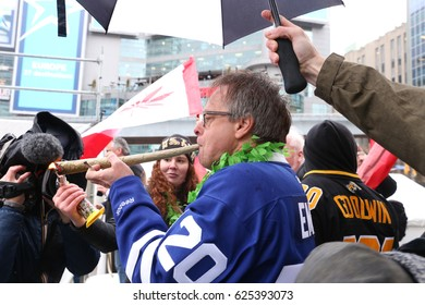TORONTO, CANADA - APRIL 20, 2017: ACTIVIST MARC EMERY AKA PRINCE OF POT SMOKES GIGANTIC JOINT at the 4/20 Day Event in Toronto.