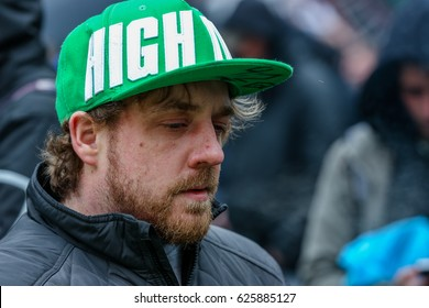 "TORONTO, CANADA - APRIL 20, 2017: MAN WEARING GREEN HAT WITH WORD ""HIGH"" ON IT THE 4/20 DAY EVENT IN TORONTO."