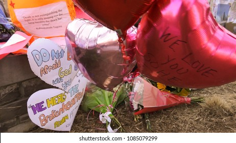 TORONTO CANADA - APRIL 2018: A memorial tribute of flowers, messages, and candles to the victims of the tragic event from van attack on Yonge and Finch Avenue on April 23, 2018