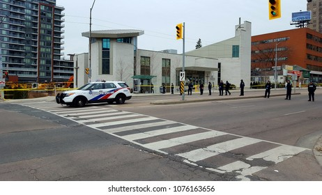 TORONTO, CANADA - APRIL 24, 2018: Police officers and vehicles checking Yonge Street the day after the van attack.