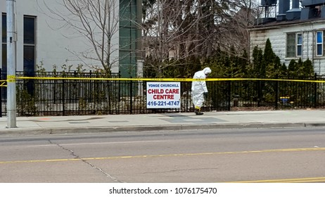 TORONTO, CANADA - APRIL 24, 2018: HazMat personnel checking for evidences and cleaning up after the van attack of April 23, 2018.