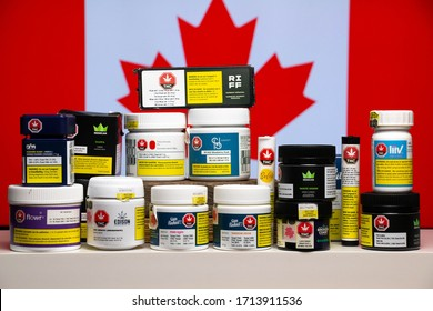 Toronto / Canada - April 24, 2020: Retail cannabis in original packaging by various licensed providers of legal marijuana in Canada. Canadian flag as a background.