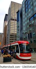 TORONTO, CANADA - APRIL 8, 2019: A TTC streetcar at a stop in Downtown Toronto, Canada.